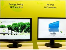 An LG Electronics energy-saving monitor next to another monitor that uses more power at the 2009 International Consumer Electronics Show
