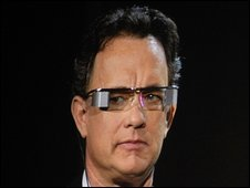 Actor Tom Hanks tries on special prototype glasses that allow you to watch a movie at the same time as looking through them