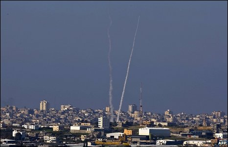 Smoke trails behind a rocket streaking into the sky above the Gaza Strip after it was launched by militants on 10 January 2009