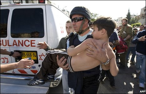 An Israeli boy is evacuated to a hospital after a rocket launched from the Gaza Strip hit the coastal Israeli city of Ashkelon on 10 January 2009