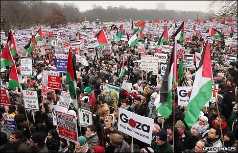 Demonstrators call for an end to conflict in Gaza, as they gather in Hyde Park in London, UK, on 10 January 2009