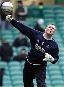 Dundee goalkeeper Rab Douglas warms up ahead of facing old side Celtic