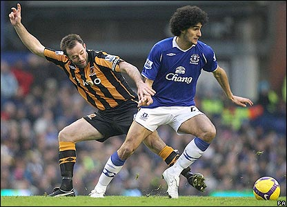 Marouane Fellaini looks to evade Ian Ashbee