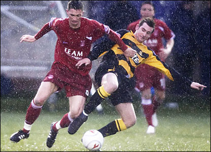 Gary McDonald (left) battles for the ball with Alloa's John Grant