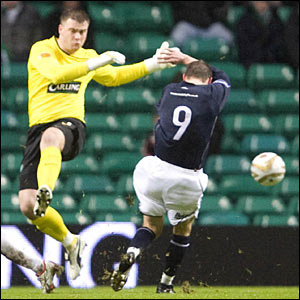 Celtic goalkeeper Artur Boruc misses a clearance to allow Dundee's Colin McMenamin (9) to score