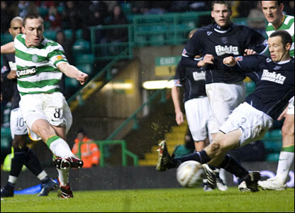 Scott Brown (left) equalises for Celtic from close range