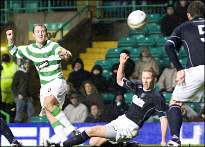 Celtic star Aiden McGeady (left) watches on as his shot heads goalwards