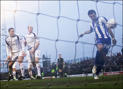 A helpless Ayr defence look on as Manuel Pascali prods the ball into the net to open the scoring for Kilmarnock