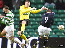 Artur Boruc misses his attempted clearance to gift Dundee a goal