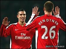 Robin van Persie congratulates Nicklas Bendtner