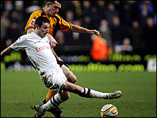Preston's Stephen Elliott battling for the ball with Neil Collins