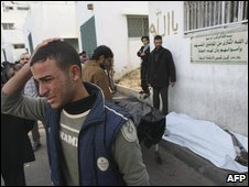 A Palestinian man mourns after the death of relatives in front of a Gaza City morgue on 11 January 2009