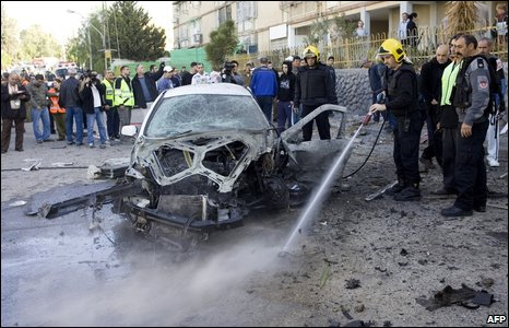The wreck of a car hit by a militant rocket in the southern Israeli city of Beersheba on 11 January 2009