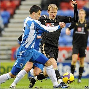 Wigan's Paul Scharner looks to thwart his Russian opponent