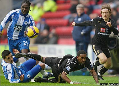 Defoe takes a tumble at the JJB Stadium