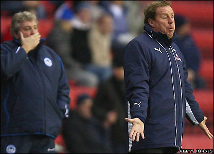 Redknapp gives instructions to his players as Bruce looks on