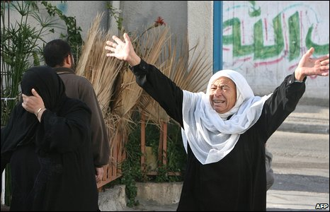 Palestinian woman mourn after the death of relatives in front of a morgue in Gaza City on 11 January 2009