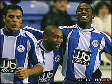 Maynor Figueroa (right) is delighted after scoring the winner