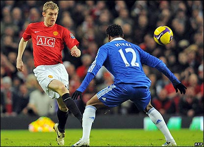 Fletcher and Mikel contest possession
