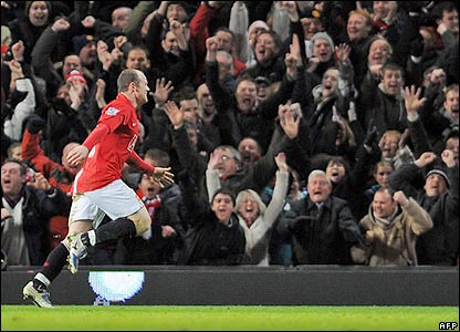 Rooney celebrates with Man Utd's fans