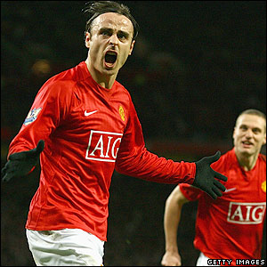 Berbatov celebrates scoring the third
