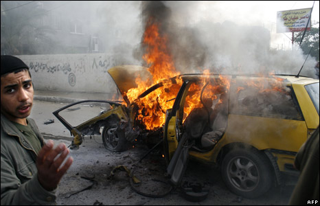 A car burns near the Rafah refugee camp in the southern Gaza Strip, 11 January 2009