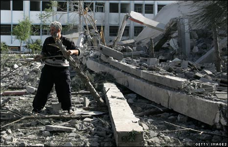 Man gathers firewood amid rubble in Gaza City, 11 January 2009