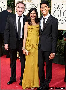 Danny Boyle (l) with Slumdog Millionaire stars Freida Pinto and Dev Patel