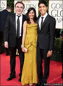 Danny Boyle (l) with Slumdog Millionaire stars Freida Pinto and Dev Patel