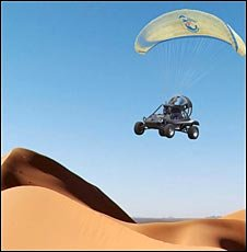 drawing of a paraglider ultralight with four wheels, street legal no less, flying over Saharan dunes