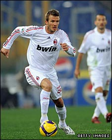 Beckham on the ball during Milan's game against Roma