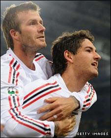 Beckham celebrates with Pato, who scored both of Milan's goals