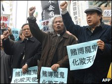 Dozens of Taiwanese demonstrators chant slogans during a protest outside parliament in Taipei on Monday against a bill aimed at lifting a ban on casinos