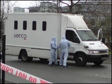 Scene of crime officers examine the prison van