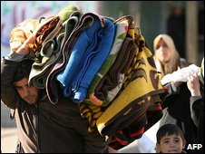 Palestinians flee their homes in Gaza City (12.1.09)