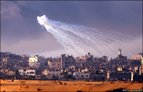 An Israeli shell explodes above the Gaza Strip