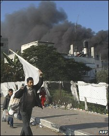 Man holds white flag as he flees Zeitun district of Gaza City