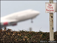 Aeroplane taking off behind protest sign