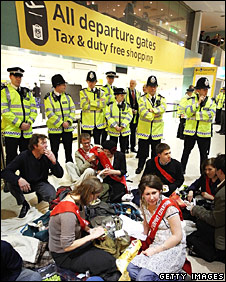 Police supervise protestors at Heathrow Airport