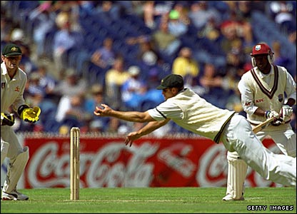 Matthew Hayden dives full length to catch Sherwin Campbell (right)