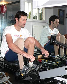 Mark Webber trains on his rowing machine as he prepares for the new Formula One season