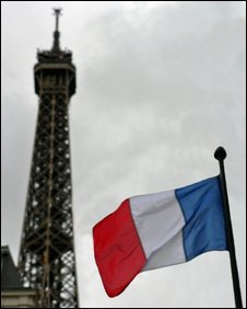 The French tricolour in front of the Eiffel Tower, Paris, France