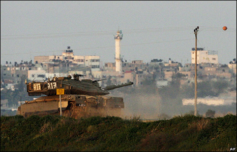 An Israeli tank moves into the Gaza Strip