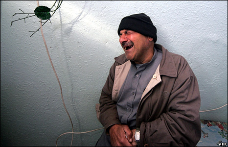 A Palestinian man cries after one of his relatives is killed in Beit Lahiya