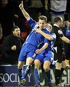 Neil Harris celebrates scoring his 112th goal for Millwall