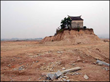 A temple stands surrounded by land cleared for the chemical plant