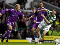 Kilmarnock players and Celtic's Andreas Hinkel