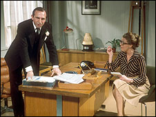 Leonard Rossier as Reggie Perrin, with Sue Nicholls as his secretary Joan