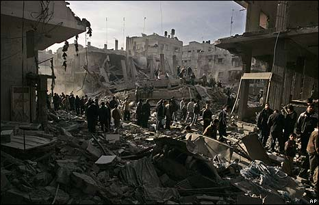 Palestinians inspect the damage at a building following an Israeli military operations in Gaza City