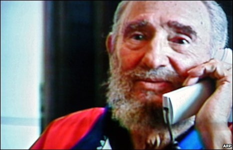 Fidel Castro is shown on television, talking on the telephone